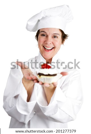 Pretty female pastry chef holding a delicious cheesecake tart topped with strawberry and chocolate.  Isolated on white.   - stock photo