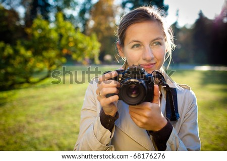 pretty female photographer outdoors - stock photo