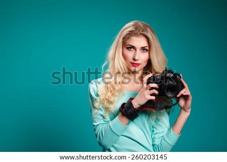 Pretty, female photographer with digital camera - stock photo