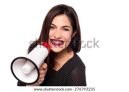 Pretty female proclaiming into the loudspeaker - stock photo