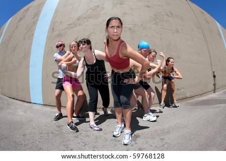 """Pretty female runner poses for her """"me"""" shot. - stock photo"""