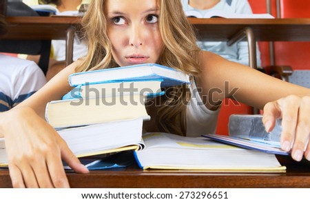 pretty female student with and book - stock photo