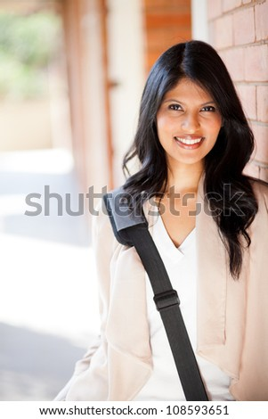 pretty female university student in school - stock photo
