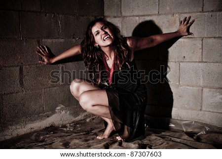 Pretty Female Vampire in a dark Corner - stock photo