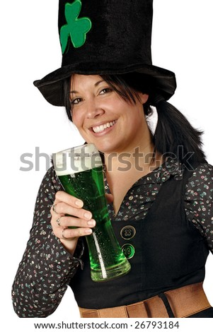 Pretty female with pigtails and hat drinking a tall glass of green beer on St. Patricks Day.