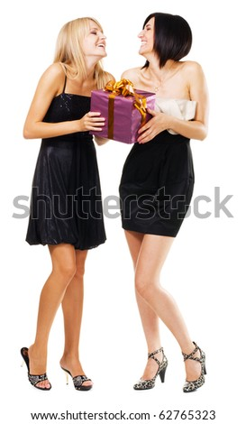 Pretty festive girls with a gift box, isolated on white - stock photo