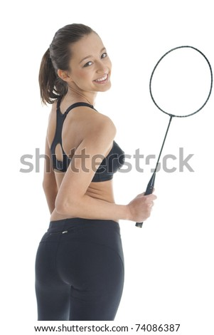 Pretty fit woman holding a badminton racket - stock photo
