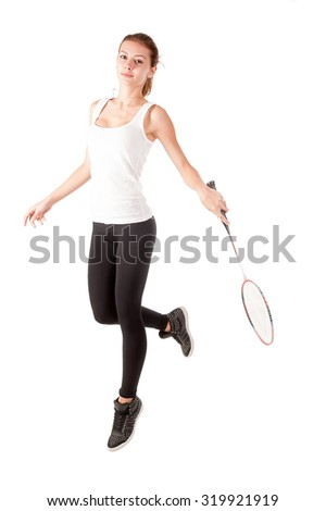 Pretty fit woman holding badminton racket and jumping. Isolated over white background - stock photo