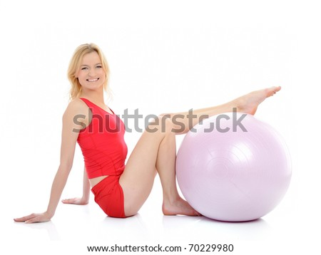 Pretty fitness woman doing exercise with pilates ball. isolated on white background - stock photo