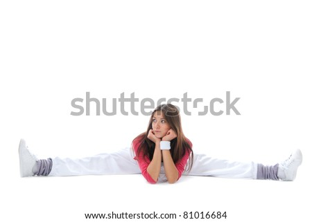 Pretty flexible dancer woman sit on twine and stretching on a white background - stock photo