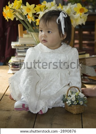 pretty flower girl in white silk dress - stock photo