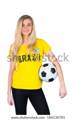 Pretty football fan in brasil tshirt on white background - stock photo