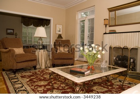pretty formal living room in upscale home - stock photo