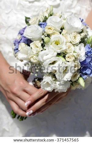 Pretty fresh elegant wedding bouquet of white roses and lilac flowers in female bride hands happy marriage floral decor closeup, vertical picture - stock photo