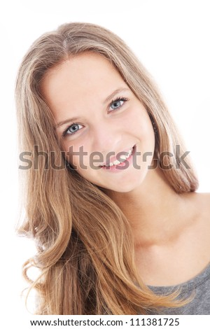 Pretty friendly teenager Pretty friendly teenager with her head slightly tilted smiling happily at the camera isolated on white - stock photo