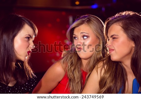 Pretty friends making funny faces at the nightclub