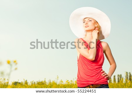 pretty girl a hat having fun in the field