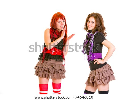 Pretty girl admiringly applauding her smiling girlfriend isolated on white - stock photo