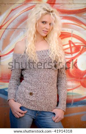 Pretty Girl Against Grafitti Wall - stock photo