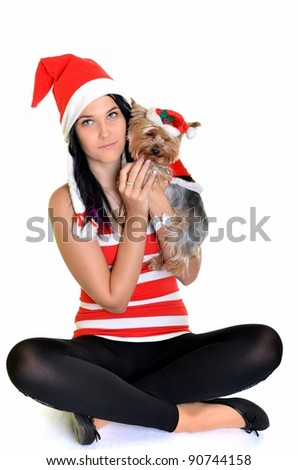 pretty girl and dog in santa hat at Christmas - stock photo