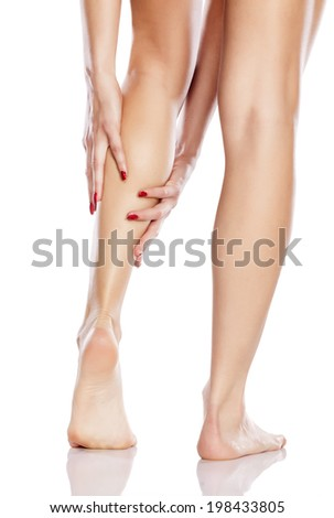 pretty girl apply cosmetics on her leg - stock photo