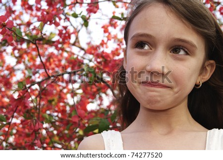 Pretty girl at the park making funny face - stock photo