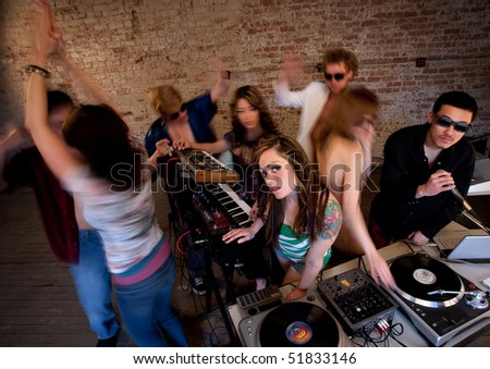 Pretty girl at turntable at a disco music party - stock photo
