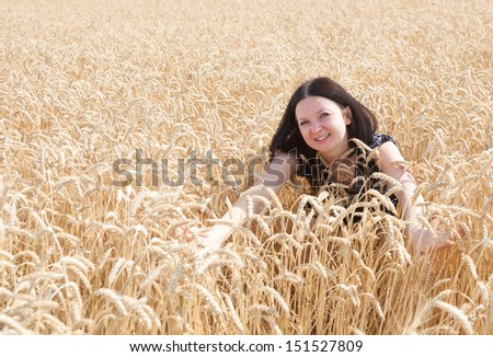 pretty girl bathes in a wheat field summer - stock photo