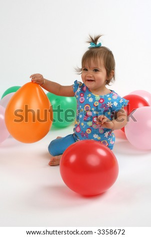 pretty girl celebrating first birthday - stock photo