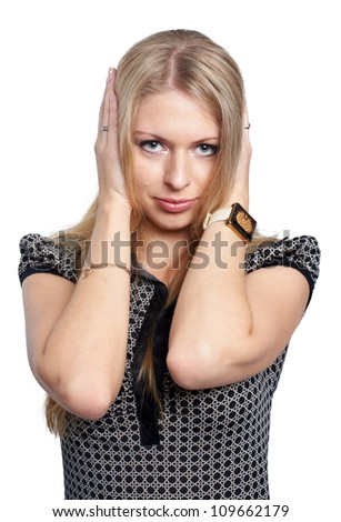 Pretty girl covering er ears - stock photo