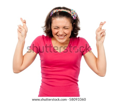 Pretty girl crossed her fingers for luck - stock photo