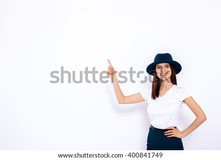 Pretty girl displaying your product Portrait of cheerful young woman displaying your product over white background - stock photo