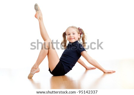 pretty girl doing gymnastics over white background - stock photo