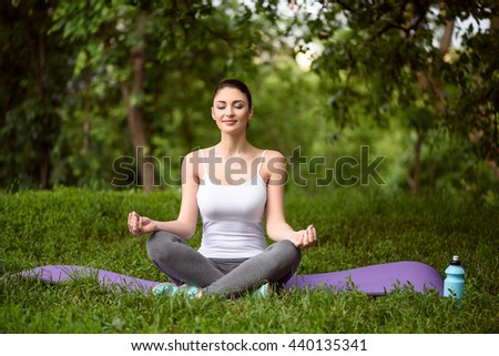 Pretty girl doing yoga in the nature - stock photo