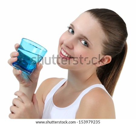 pretty girl drinking water from glass