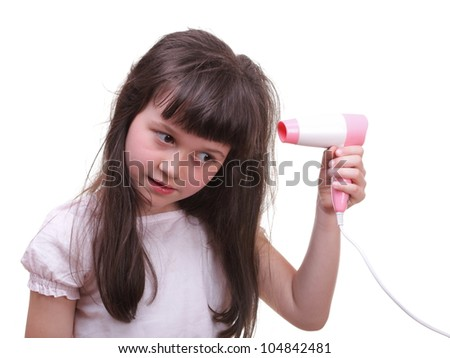 Pretty girl drying her hair hairdryer isolated on white