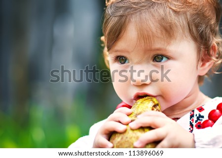 Pretty girl eating a pear