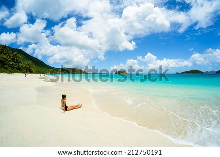 Pretty girl enjoying a beautiful Caribbean beach in Saint John in the United States Virgin Islands. - stock photo