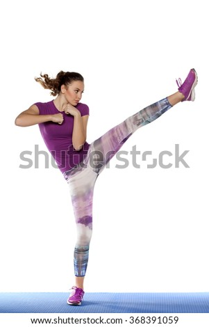 pretty girl exercise foot kick - stock photo