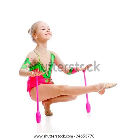 pretty girl gymnast doing exercises over white - stock photo