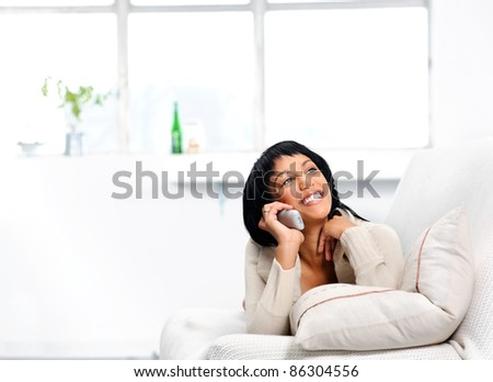 Pretty girl having a nice chat over the phone - stock photo