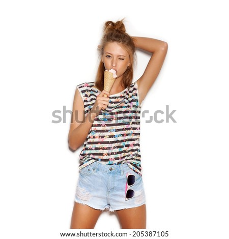 Pretty girl having fun and eating ice cream. Smeared face. White background, not isolated - stock photo