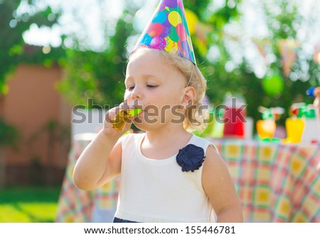 Pretty girl having fun at child's birthday party