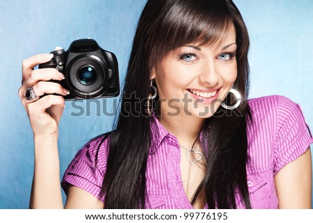 pretty girl hold digital camera - stock photo