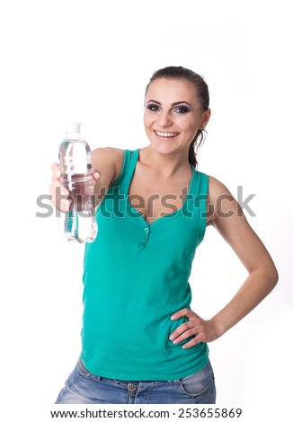 Pretty girl holding bottle with water isolated on white background - stock photo