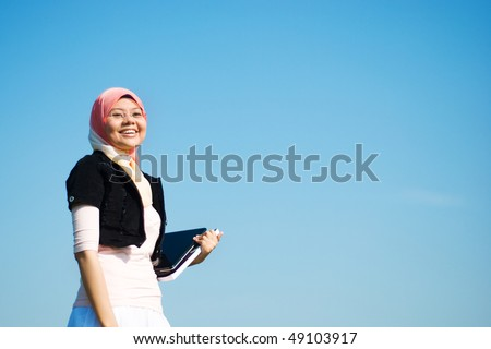 pretty girl holding laptop and book - stock photo
