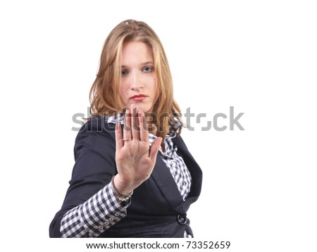 Pretty girl holding up hand and gesturing no and stop. Focus on hand - stock photo