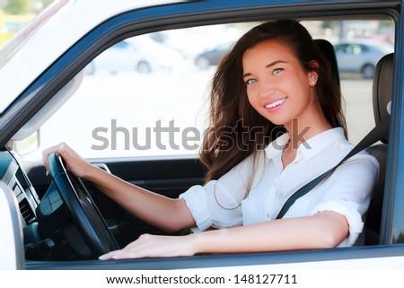 Pretty girl in a car  - stock photo