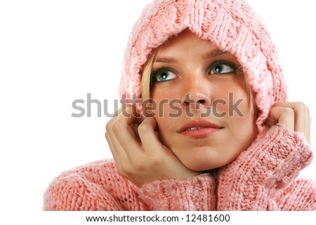 Pretty girl in a pink sweater with a hood looking off into the distance