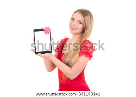 Pretty girl in a santa hat on new year holding tablet computer touch pad gadget with isolated white screen and bow - stock photo
